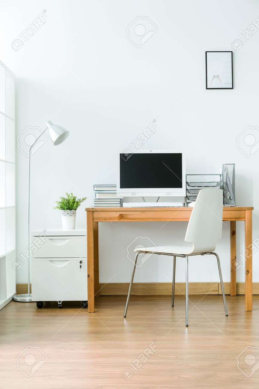 Study Room With Wood Flooring And Simple Light Furniture Stock