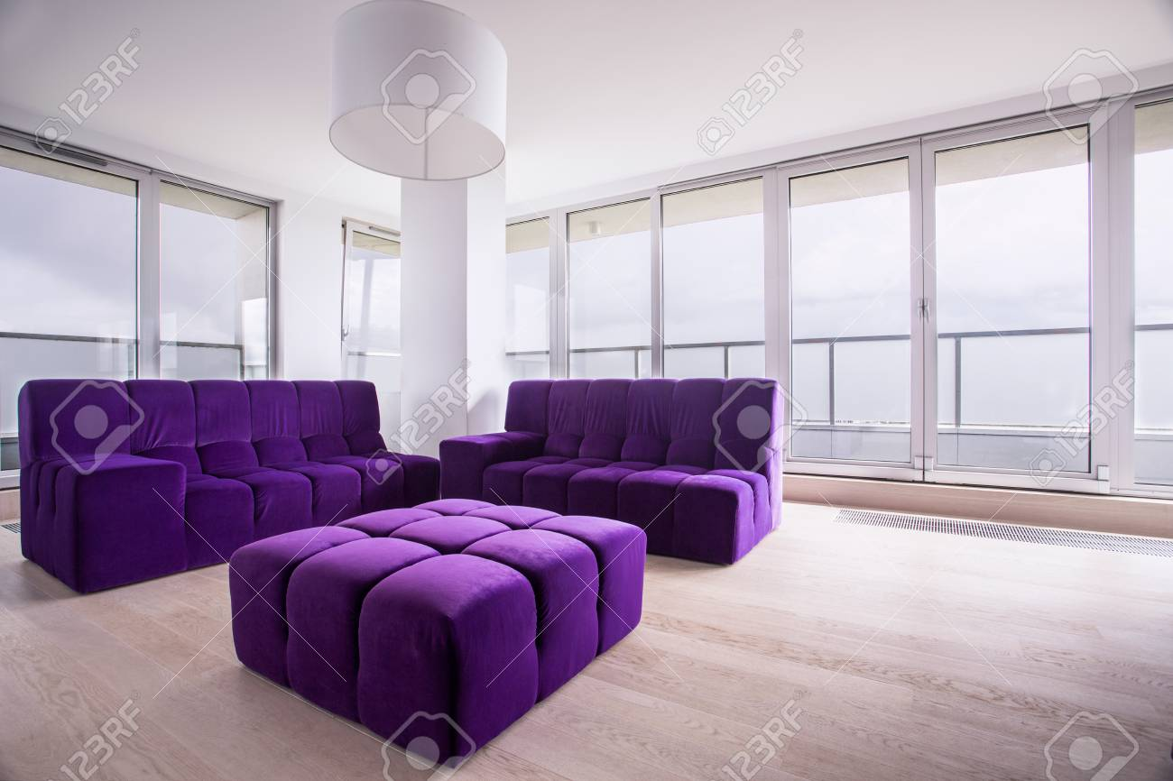 Modern Violet Hassock And Sofa In Living Room Stock Photo, Picture ...