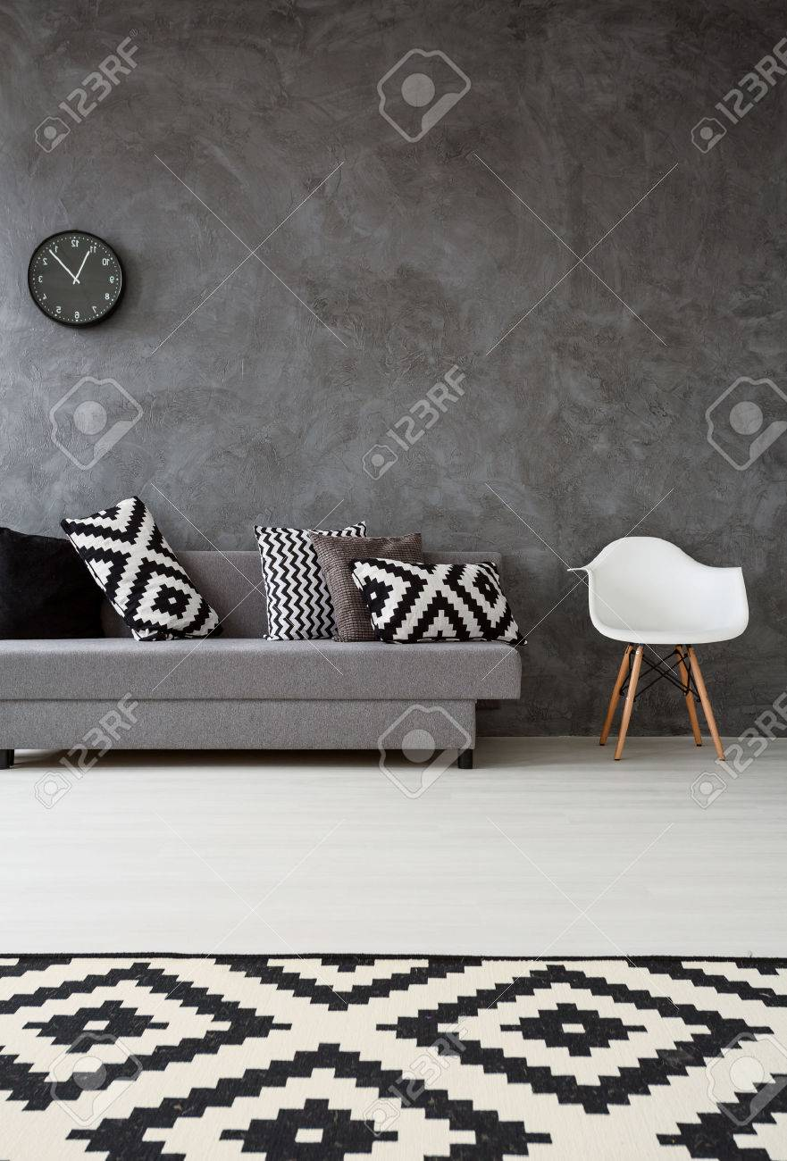 Grey Living Room With Sofa Chair Pattern Carpet And Pillows In Black White