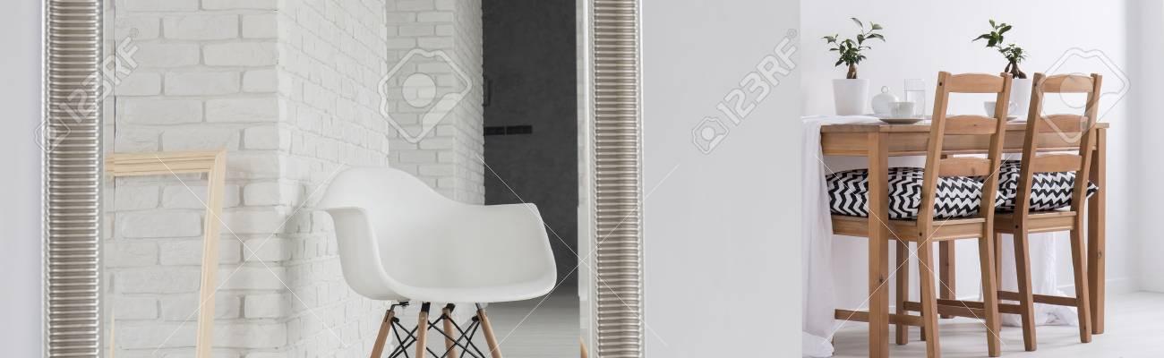 Elegante Sala Da Pranzo Bianco Con Mobili In Legno Collegata Con ...