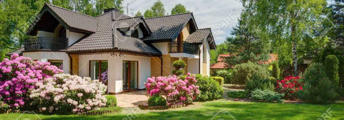 House With Beautiful Garden Full Of Flowers Stock Photo Picture