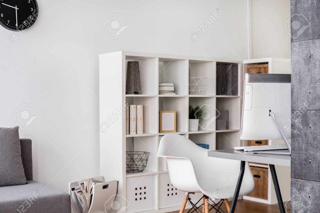 Bright Corner Of A Living Room With Computer Desk Chair And