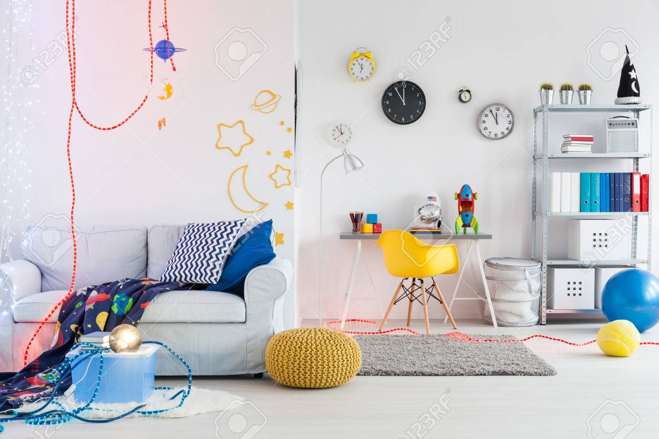 Shot of a spacious space themed room for children stock photo 56474811
