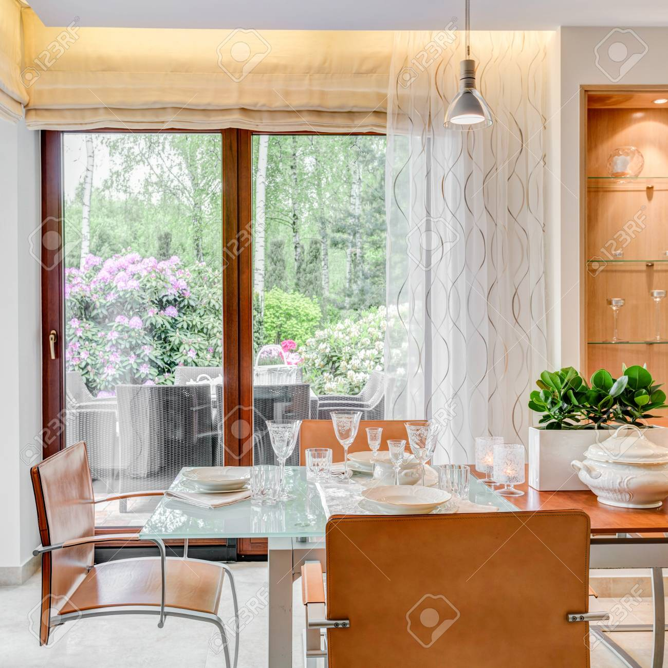 Modern Style Dining Room With Large Windows Stock Photo Picture And Royalty Free Image Image 57023630