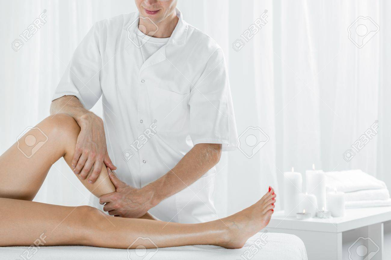 Professional masseur doing manual lymphatic drainage light interior professional masseur doing manual lymphatic drainage light interior stock photo 57023772 solutioingenieria Choice Image
