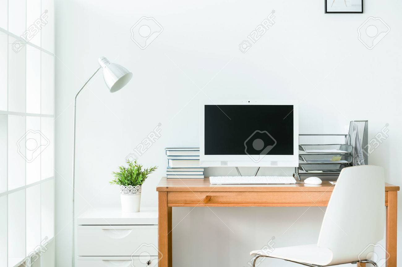 Tidy Home Office With Wooden Table And White Computer On It... Stock ...