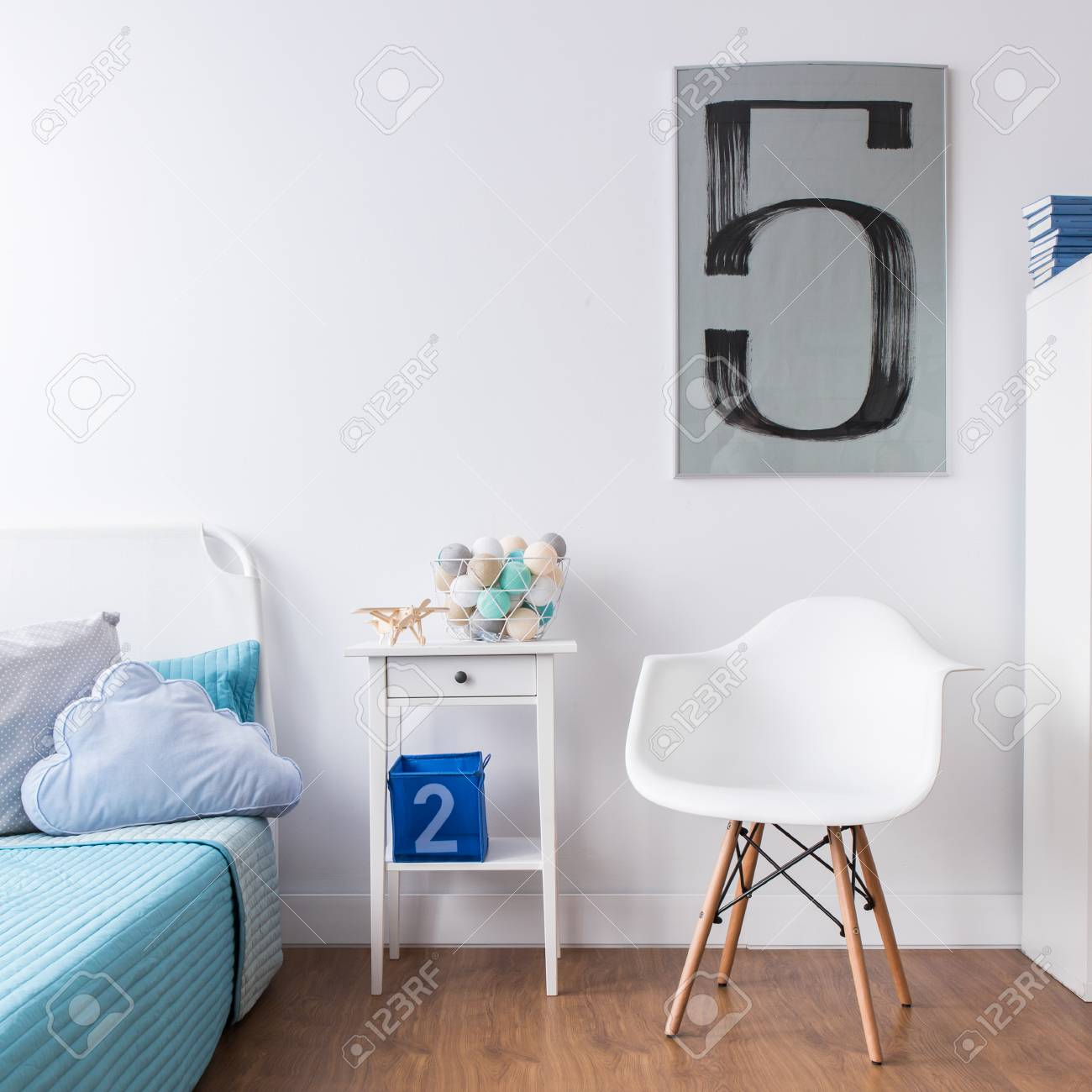 Child bedroom in light colors with bed and stylish chair