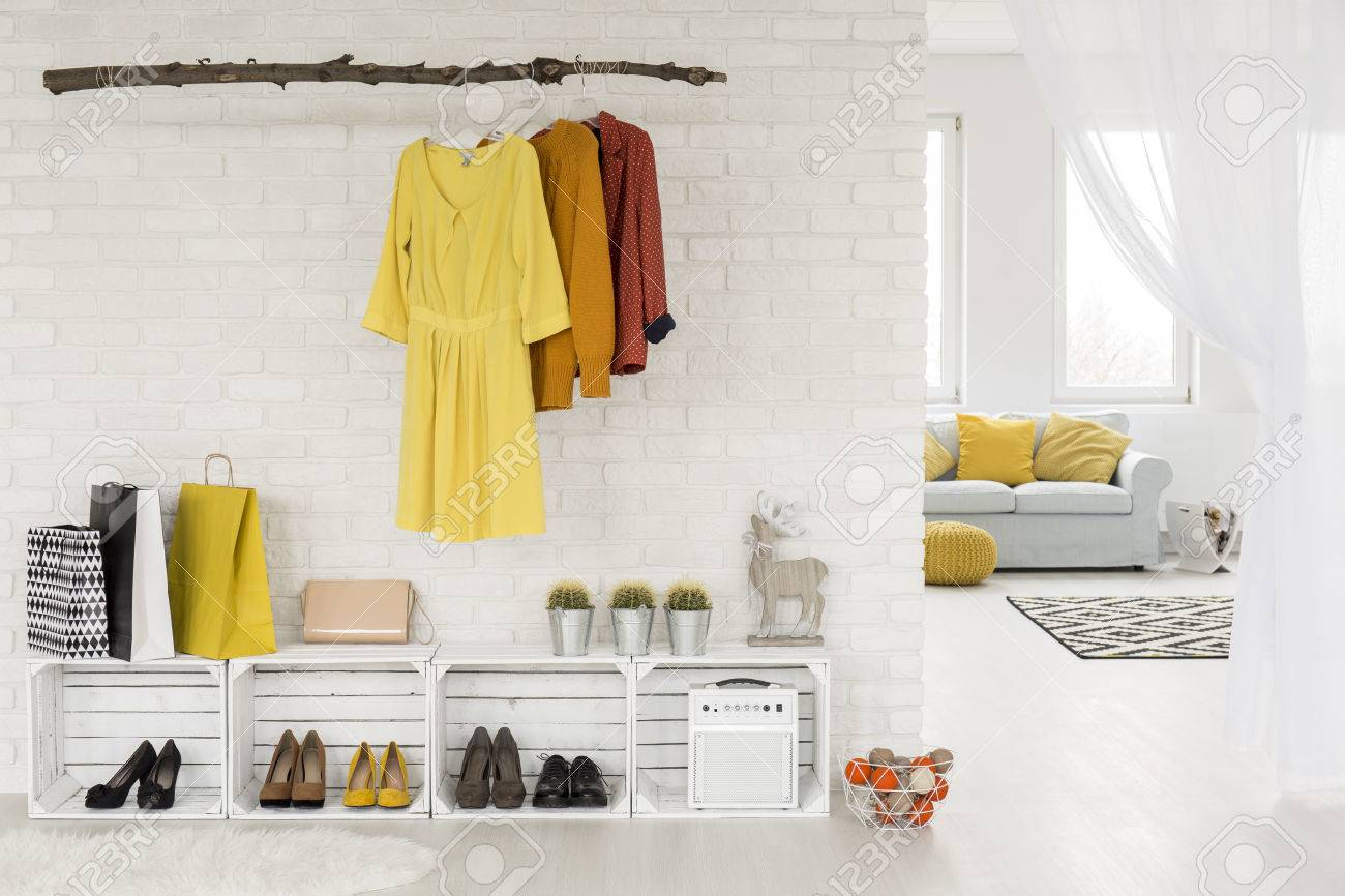 open closet design idea with hanging rack and diy shoes racks stock