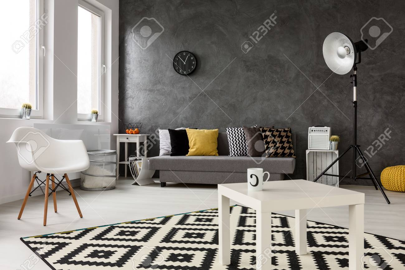 Spacious Lounge With Modern Stylish Design Grey Walls And White Wooden Parquet On The