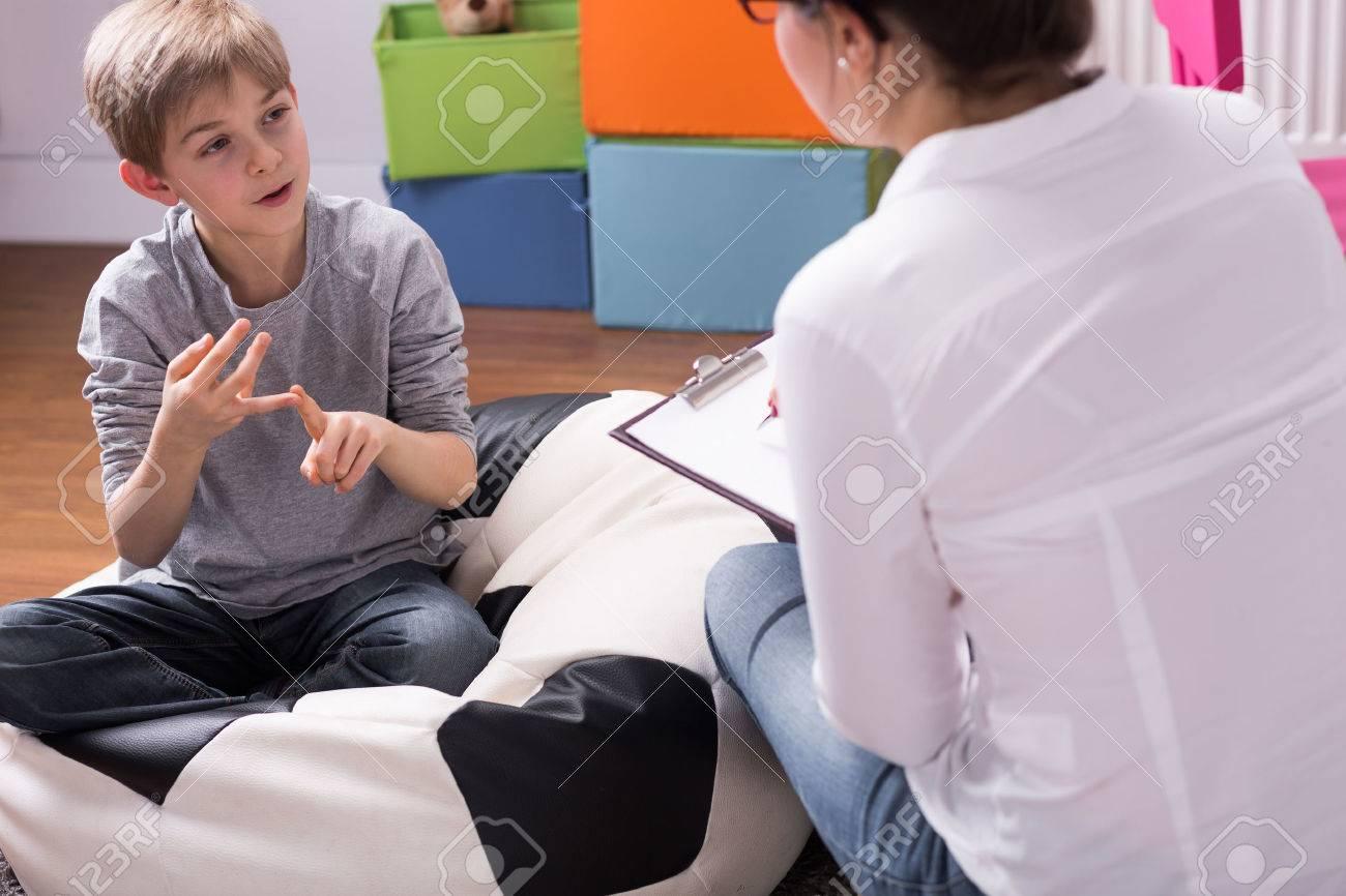Shot of a little boy talking to a psychologist - 59136147