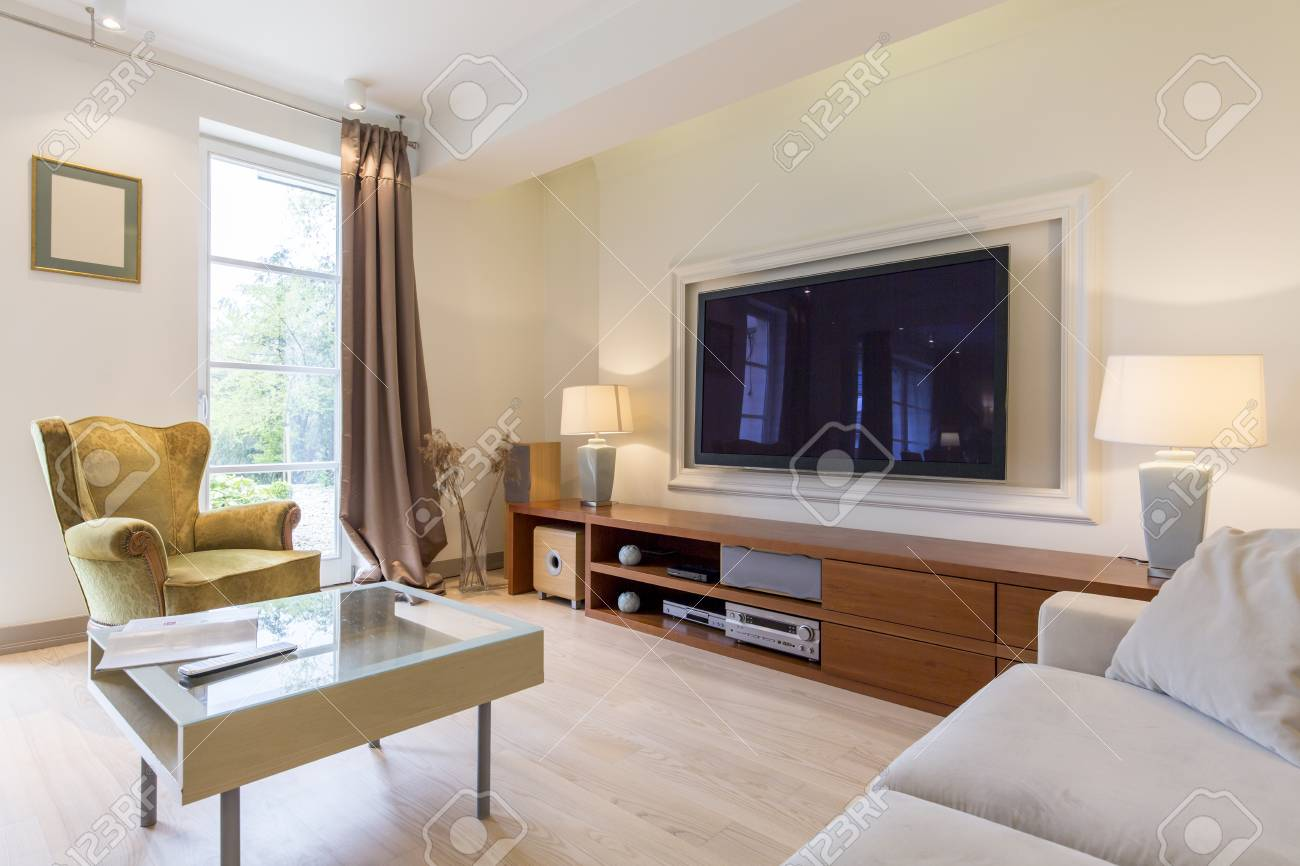 Stylish Living Room With Comfortable Armchair Small Table Sofa And Big Tv Stock Photo Picture And Royalty Free Image Image 57971096
