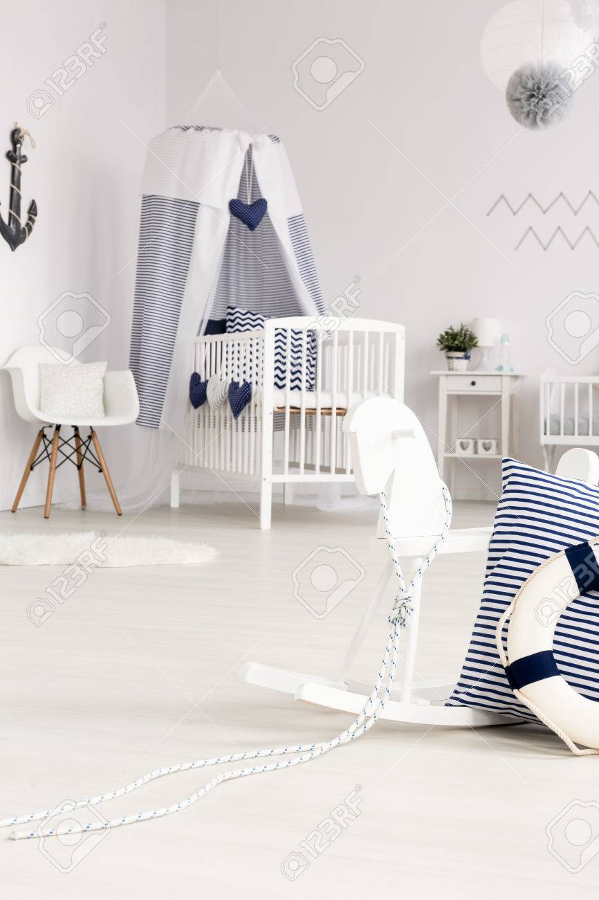 Beautiful White Baby Room With Crib And Rocking Horse With ...