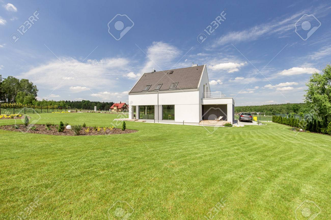 Shot Of A Small Detached House With A Big Garden Stock Photo Picture And Royalty Free Image Image 58408637