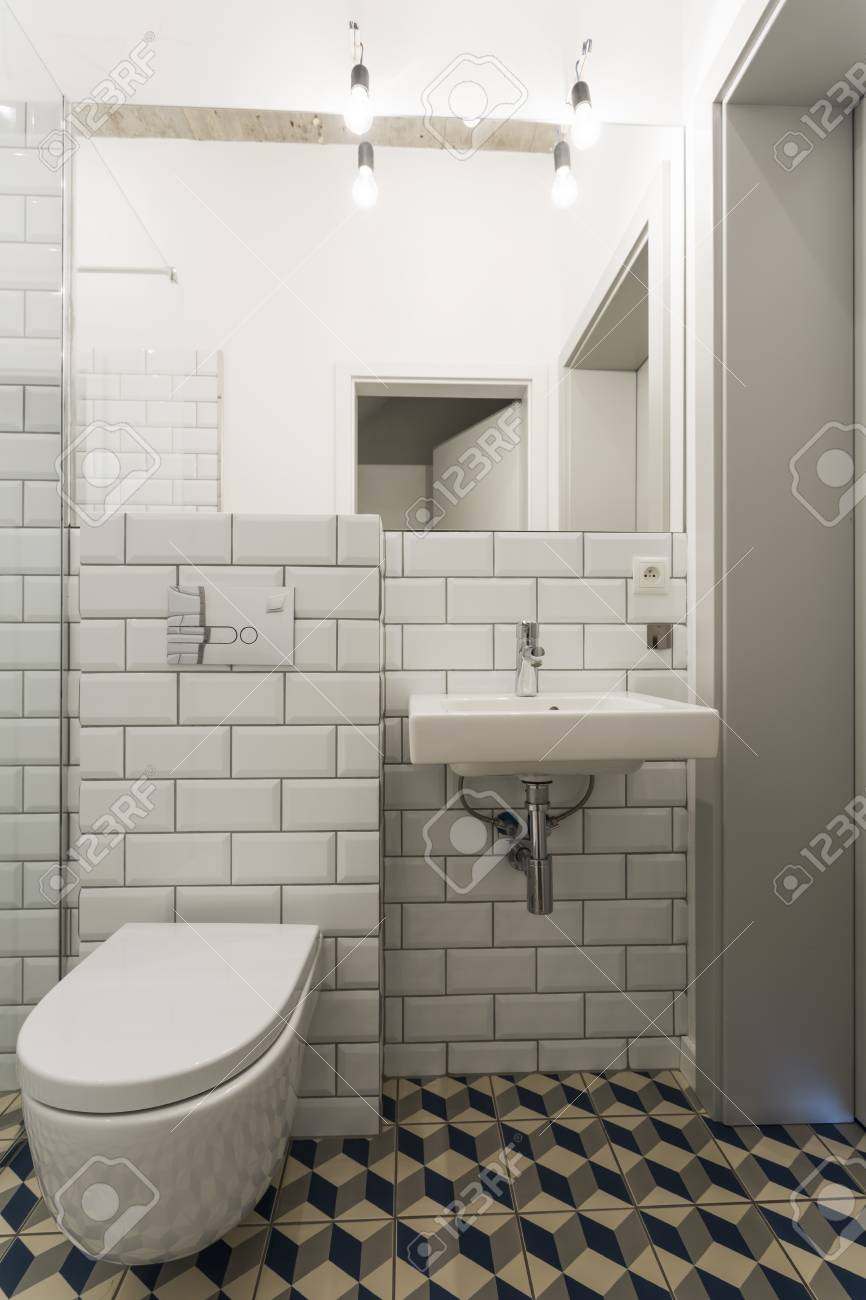 Attrayant New Bathroom With A Mirror, Basin, Toilet And White Brick Effect Tiles  Stock Photo