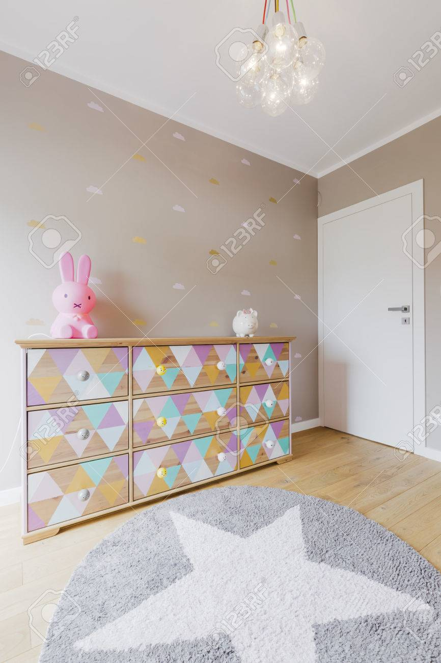 Baby Girl Room With A Colorful Commode, Deocrative Chandelier ...