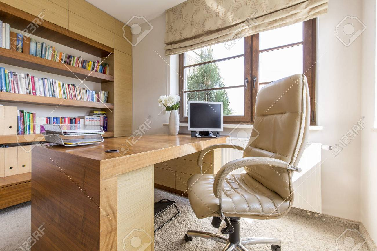 Shot Of A Modern Study With A Big Wooden Desk Stock Photo   58953877