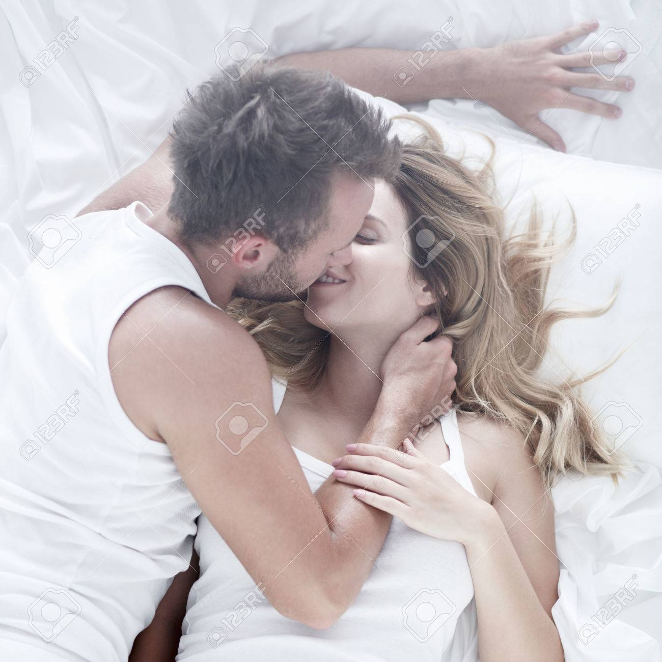 Image Of Couple During Passionate Foreplay In Bed Stock Photo 58953968