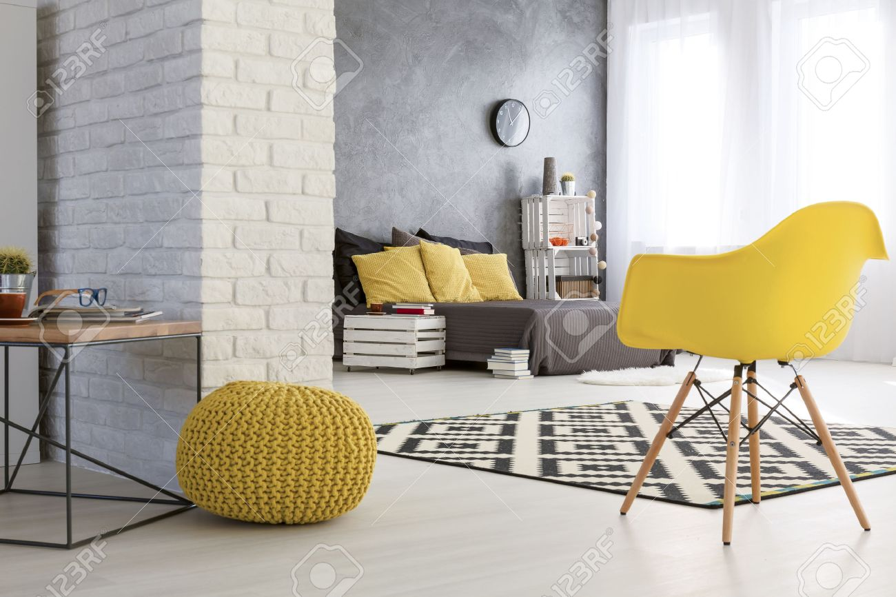 Bedroom chairs and table - Spacious Bedroom With White Brick Wall Wooden Coffee Table And Yellows Chairs By The
