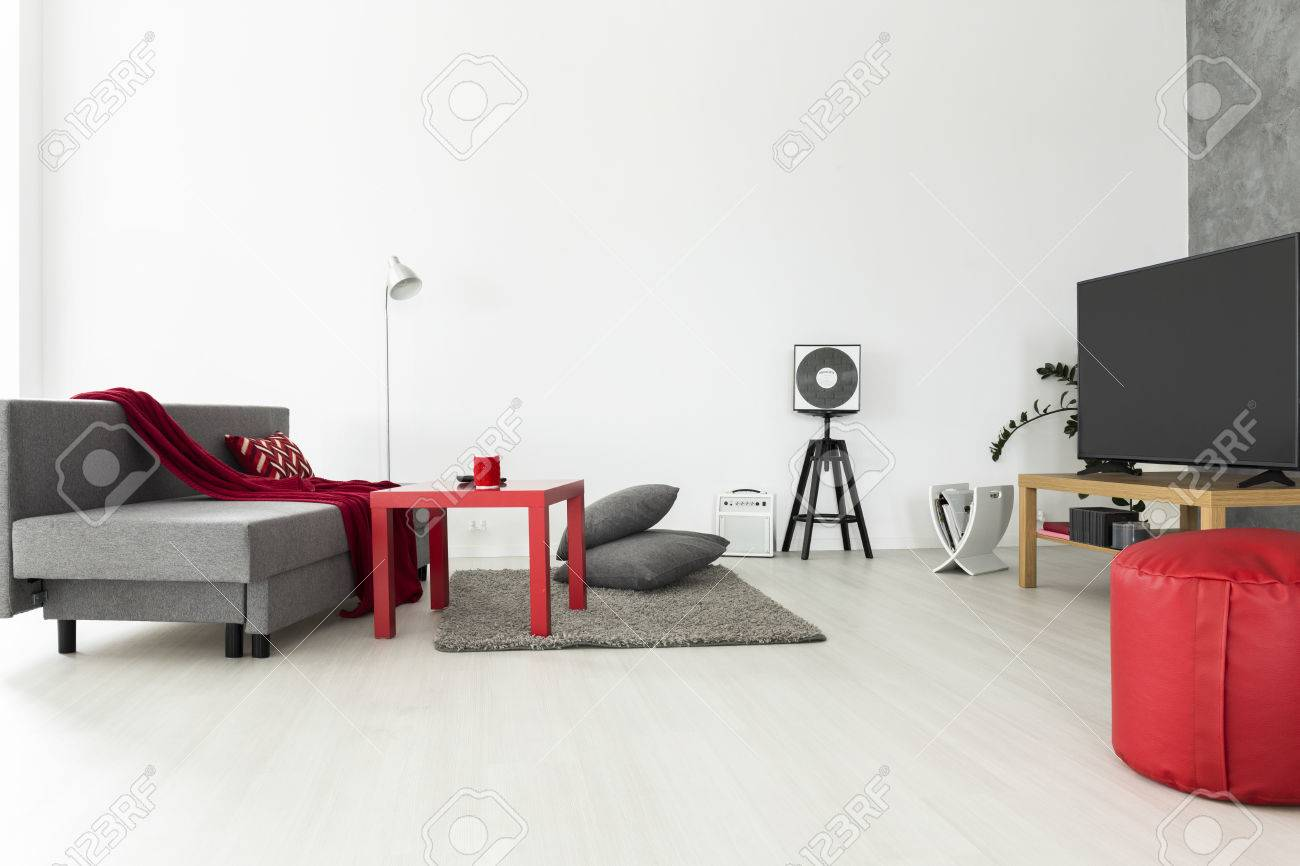 Bright And Airy Living Room With Grey Furniture And Red Accessories ...