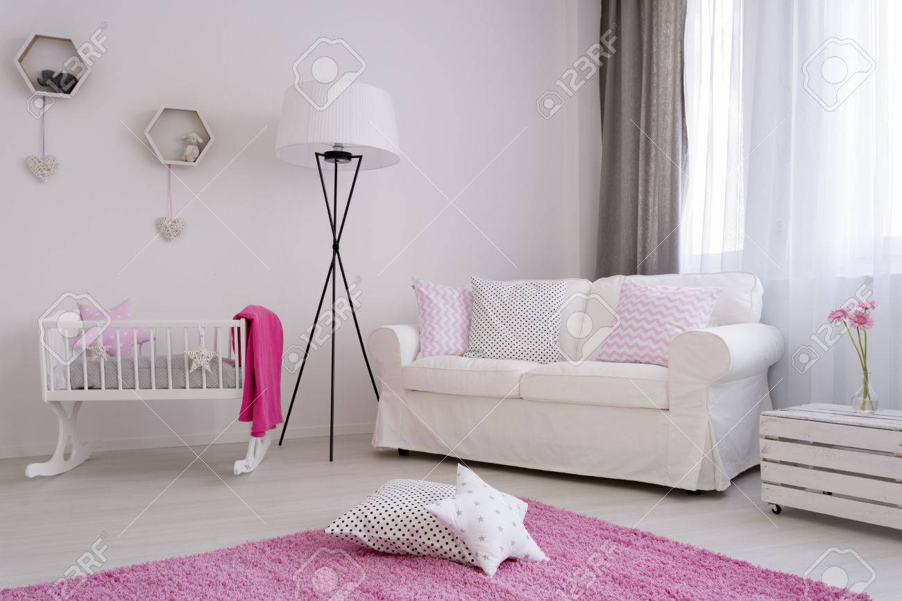Amazing Corner Of A Baby Girls Room With White Sofa Cradle And A Pink Dailytribune Chair Design For Home Dailytribuneorg