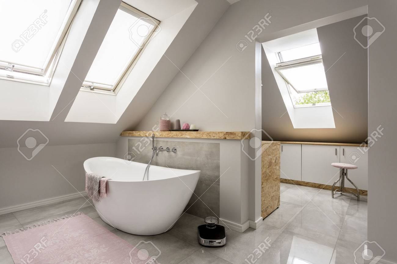 Bon Spacious Light Attic Bathroom With New Large Bathtub Stock Photo   59733457
