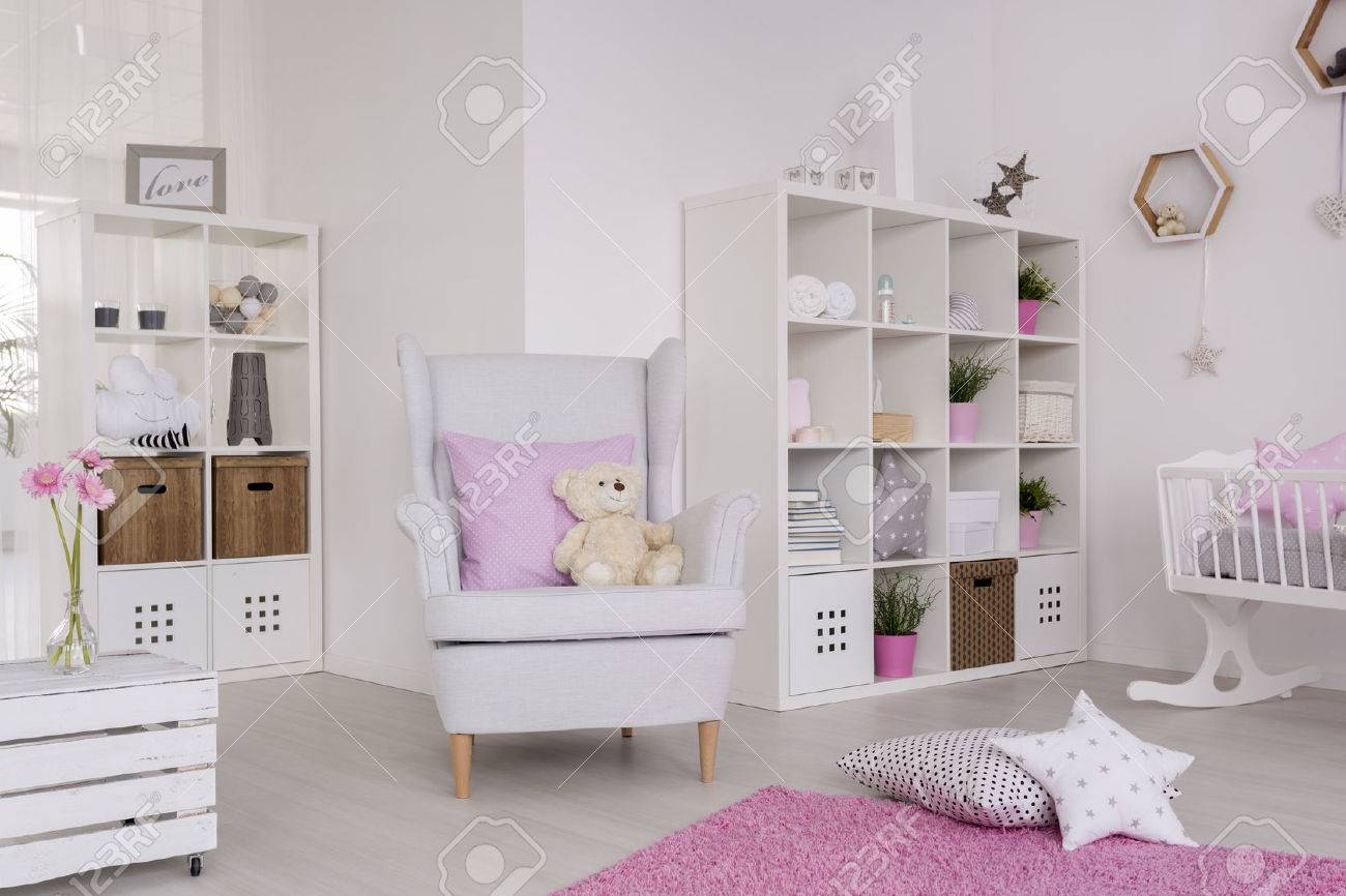 Stock Photo   White Wing Chair In A Cute Baby Room, Surrounded With Baby  Room Furniture And Pastel Decorations