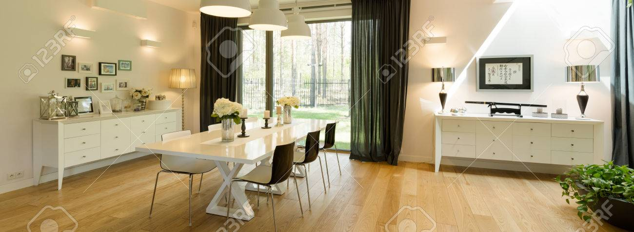 Very Spacious And Elegant Dining Room In A Luxurious House With Large Terrace Window Overlooking