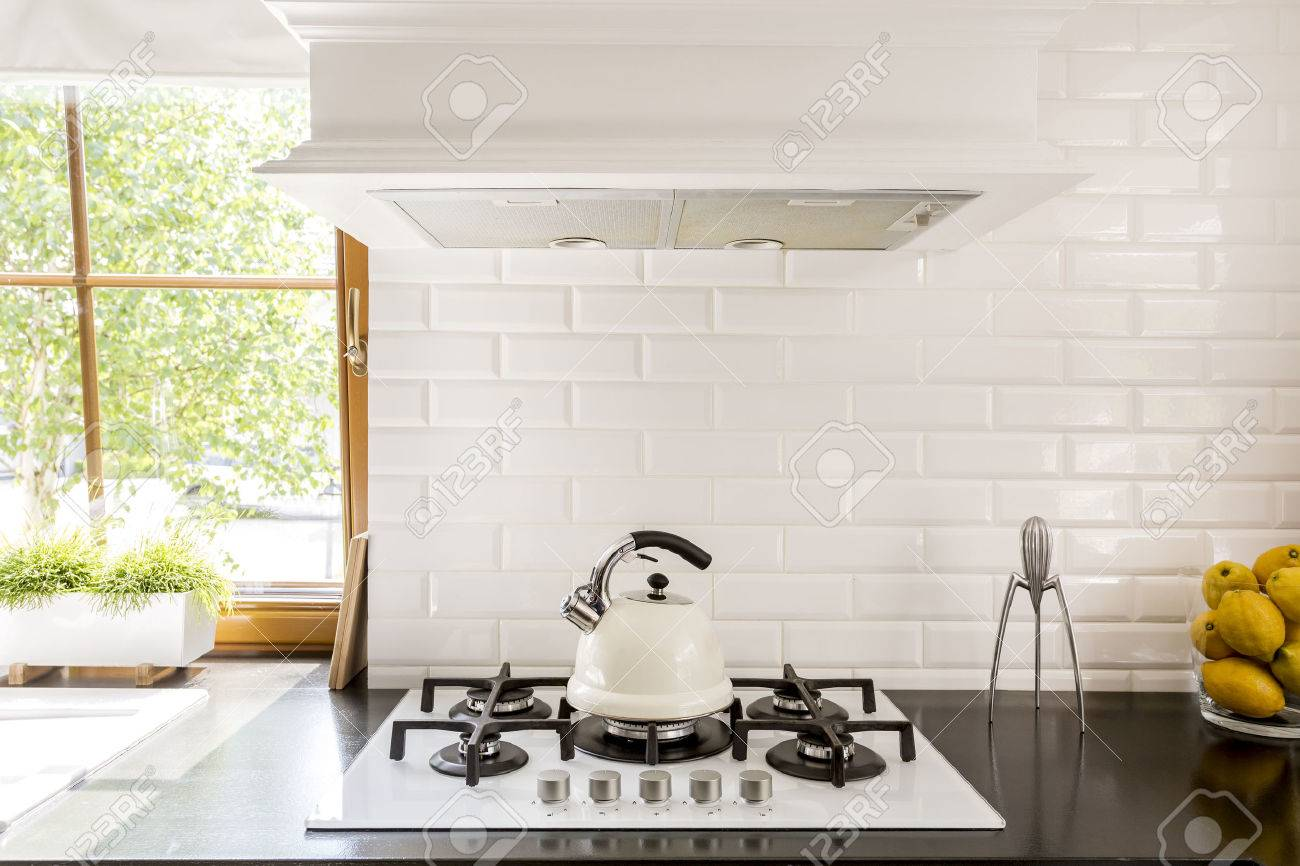 - New Style Kitchen With Dark Worktop, White Gas Cooker And