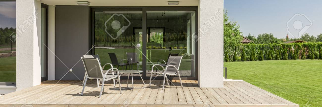 Panoramic Close Up Of A Terrace In A Modern Suburban House, With Board Deck