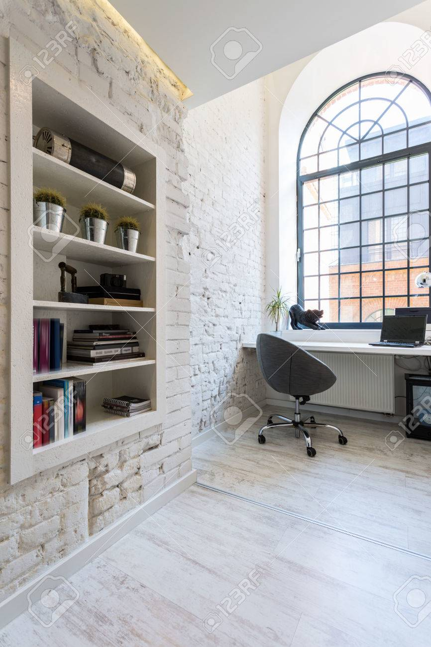 bright office. Bright Office Room With Exposed Brick Wall, Light Flooring, Simple Desk And Comfortable Chair