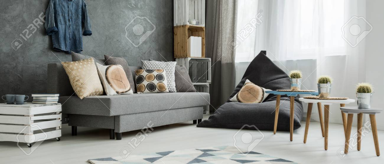 Grey Corner Of A Modern Apartment, With A Comfy Sofa And A Sitting ...