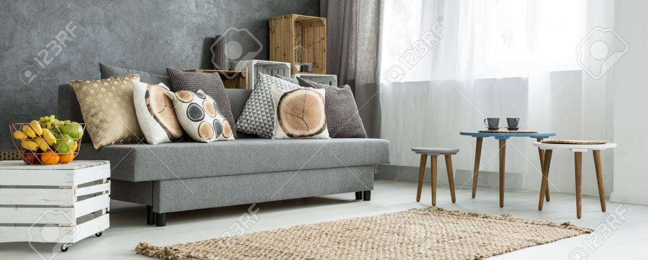 Cosy Corner Of A Modern Apartment, With A Grey Sofa Decorated ...