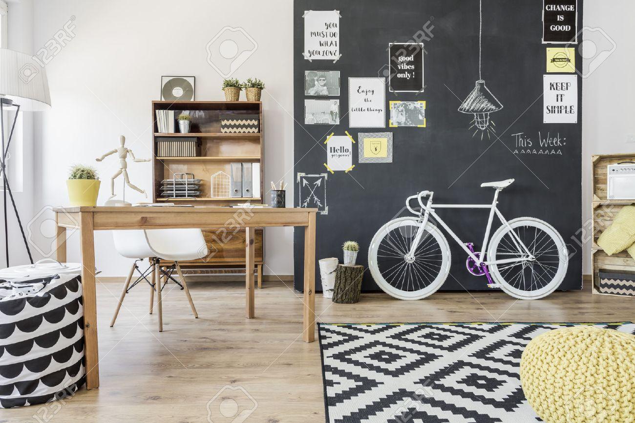 New design flat with blackboard wall, bike, desk, chair and pattern details Standard-Bild - 60417670