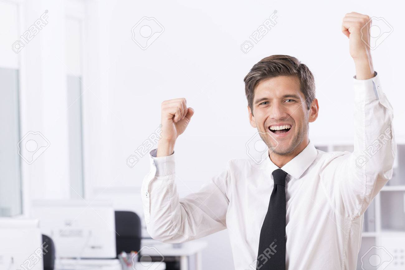 Shot of a happy business owner enjoying his victory - 60570044