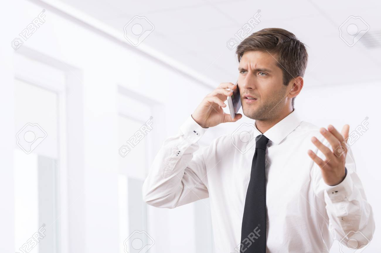 Cropped Shot Of An Unhappy Employee Arguing With Someone On The