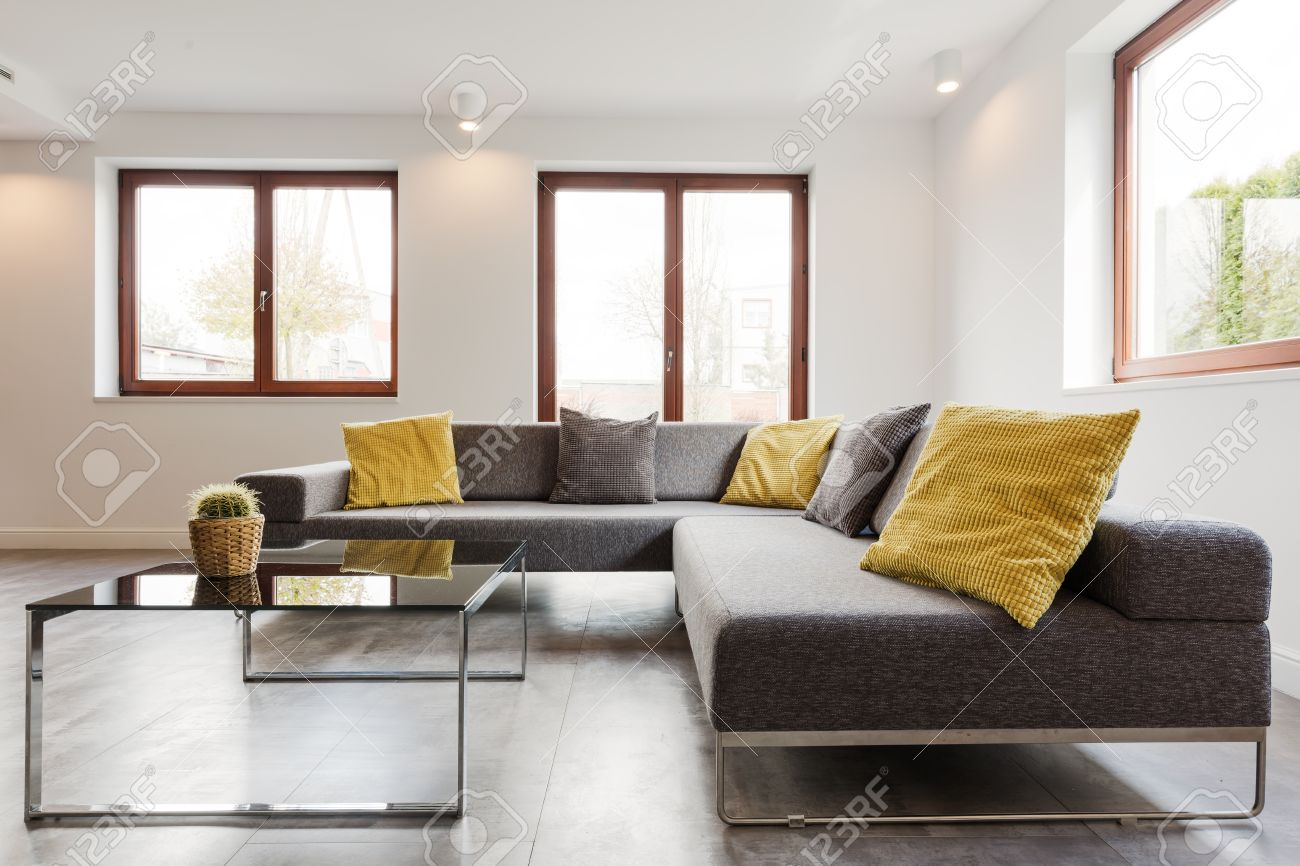 Wondrous Large Corner Sofa And Glass Coffee Table In A Very Modern And Beatyapartments Chair Design Images Beatyapartmentscom