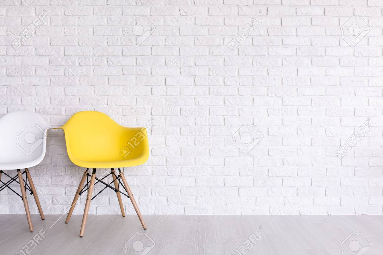 Beau Stock Photo   White And Yellow Chairs On The Background Of A White Brick  Wall