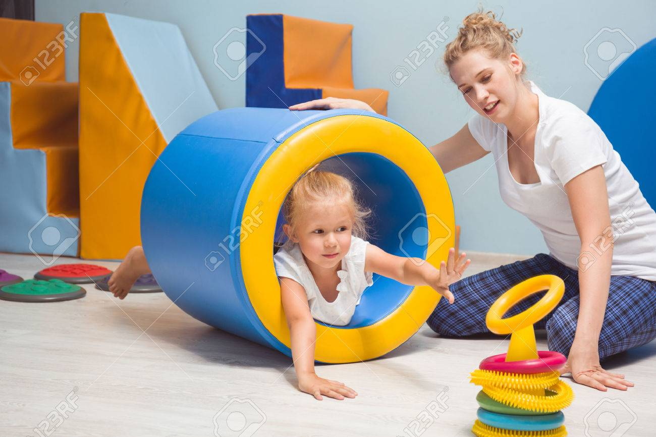 Young blonde girl lying in the cylindrical mattress - 60772316