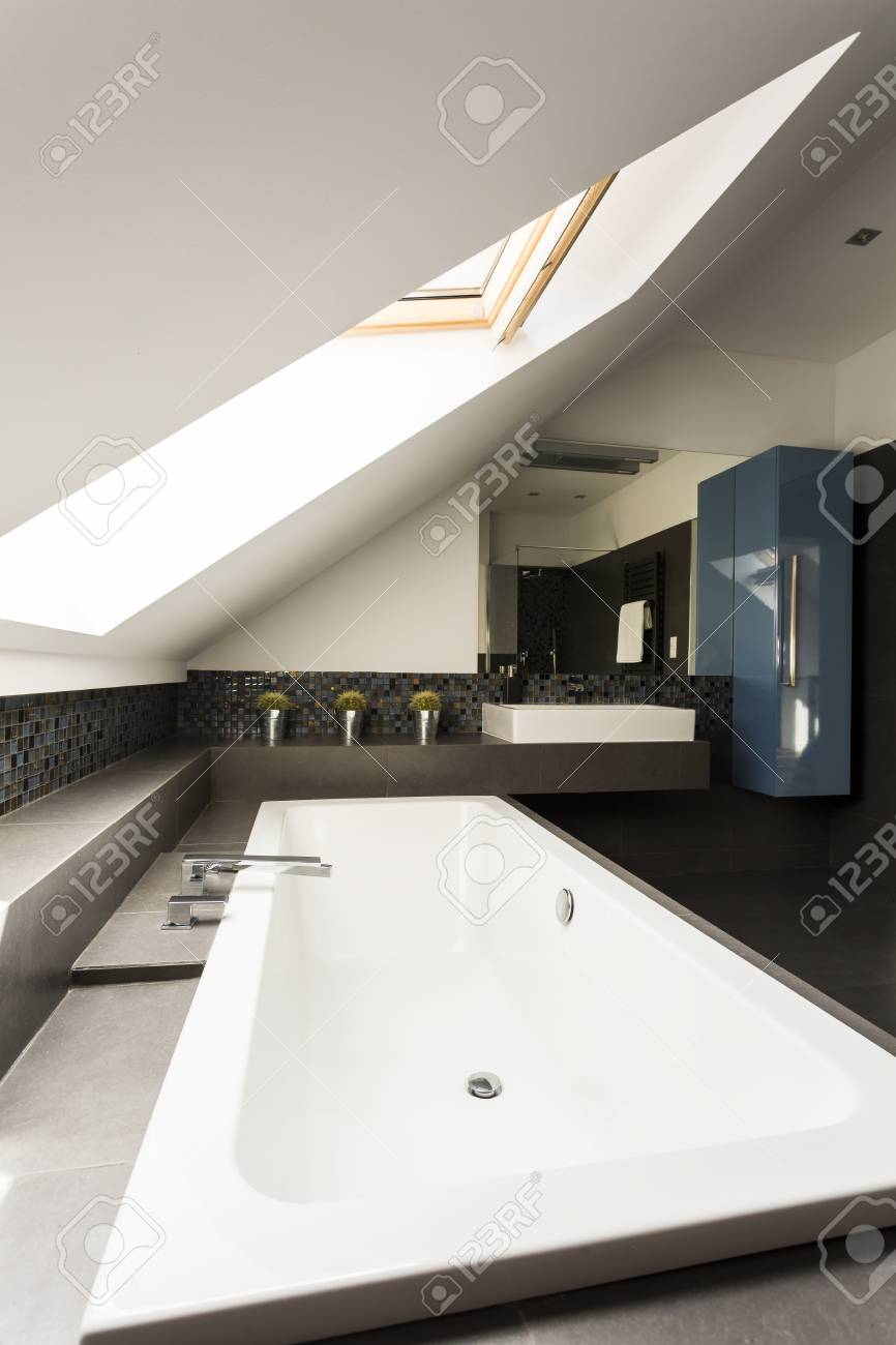 Image Of A Large Bathtub In A Black And White Attic Bathroom Stock ...