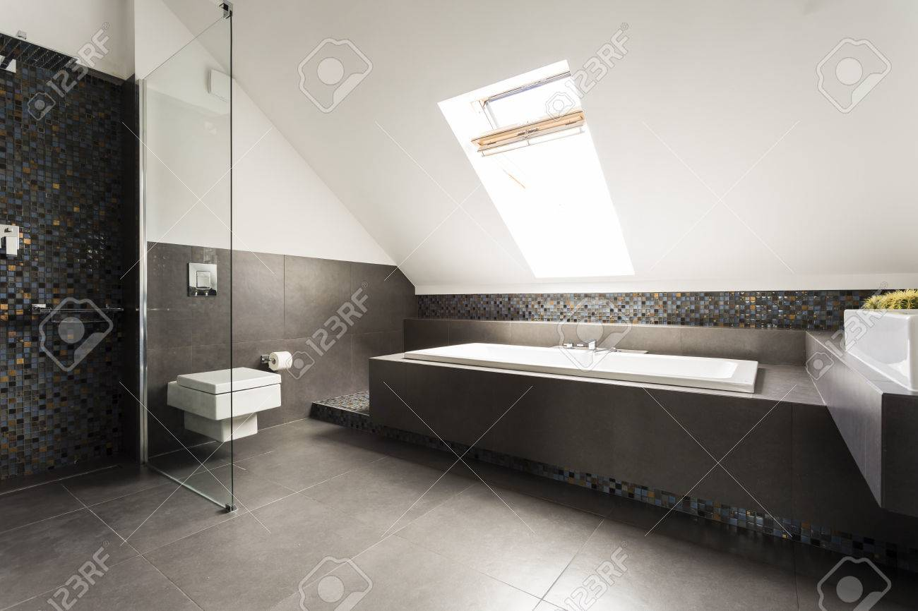 New Design Attic Bathroom In Black And White With Shower, Bathtub And  Toilet Stock Photo