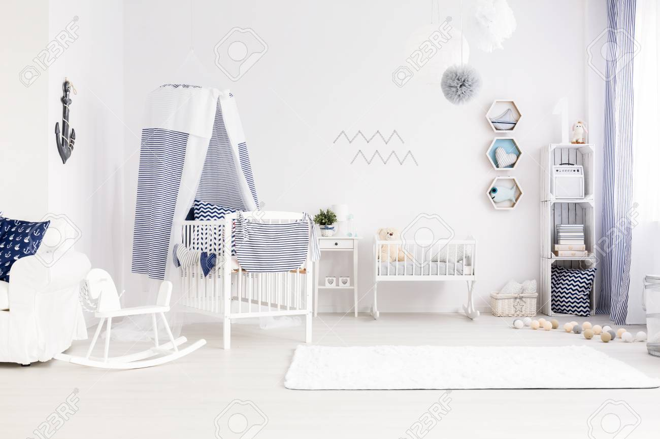 Stock Photo   Very Bright And Pure Baby Room Decor In Marine Style, With  Canopy Cot, White Cradle And Carpet