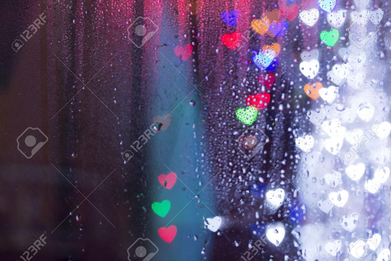 Raindrops And Colorful Bokeh Hearts Lights Rain Bokeh