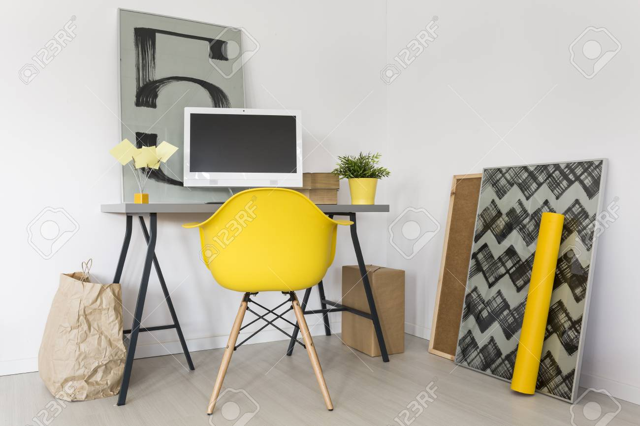 Superb Shot Of A Minimalist Workplace With Grey Desk And Yellow Office Cjindustries Chair Design For Home Cjindustriesco