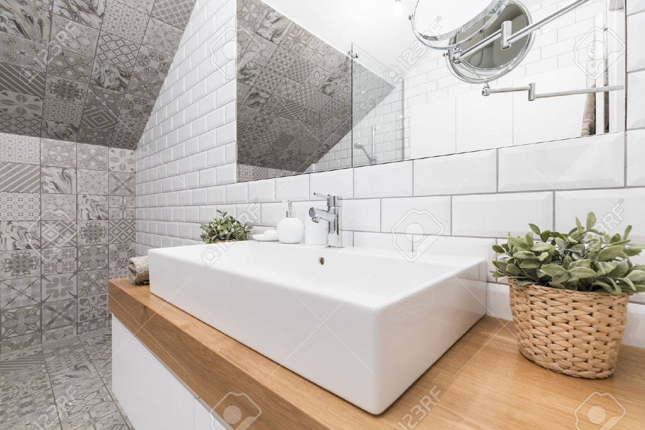 Contemporary Bathroom Corner With Decorative Tiles And A Rectangular ...