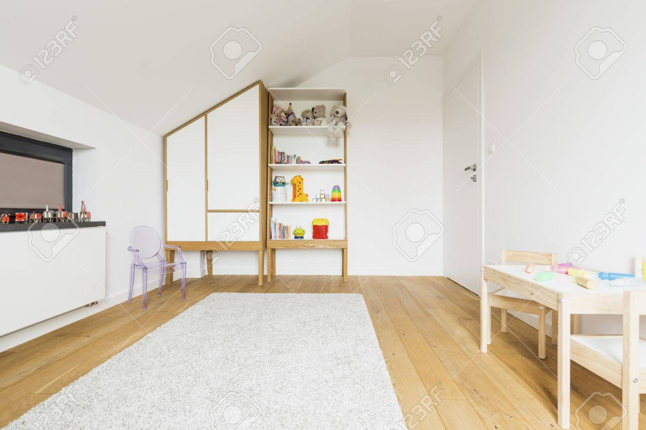 Bright Kids\' Room In An Attic, With Wooden Floor And White Furniture ...