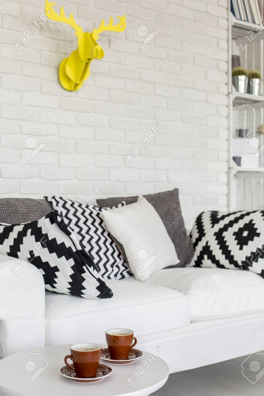 Close Up Of A White Comfortable Sofa With Decorative Cushions Stock Photo Picture And Royalty Free Image Image 61583922