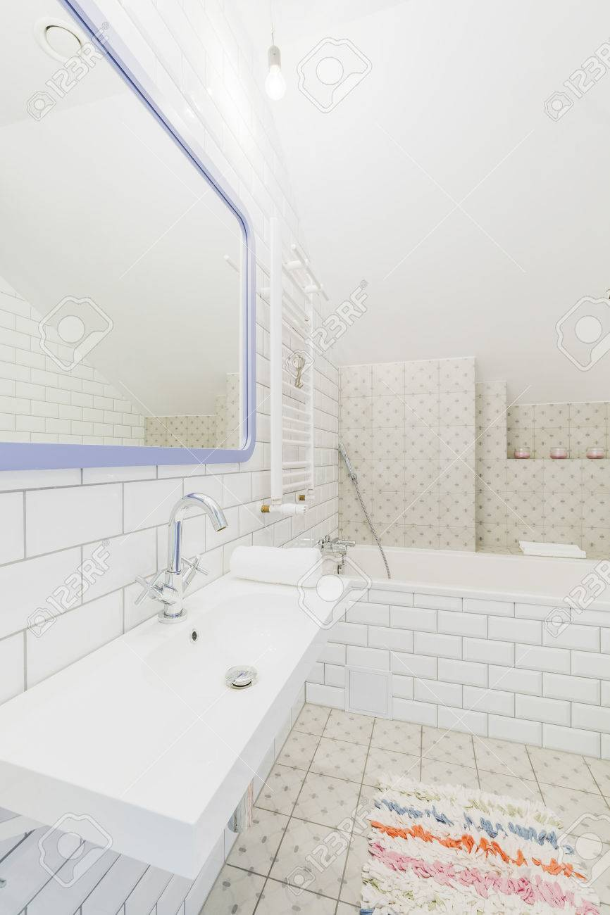 Minimalist Bathroom In White, Brick-resembling Tiles, With A.. Stock ...
