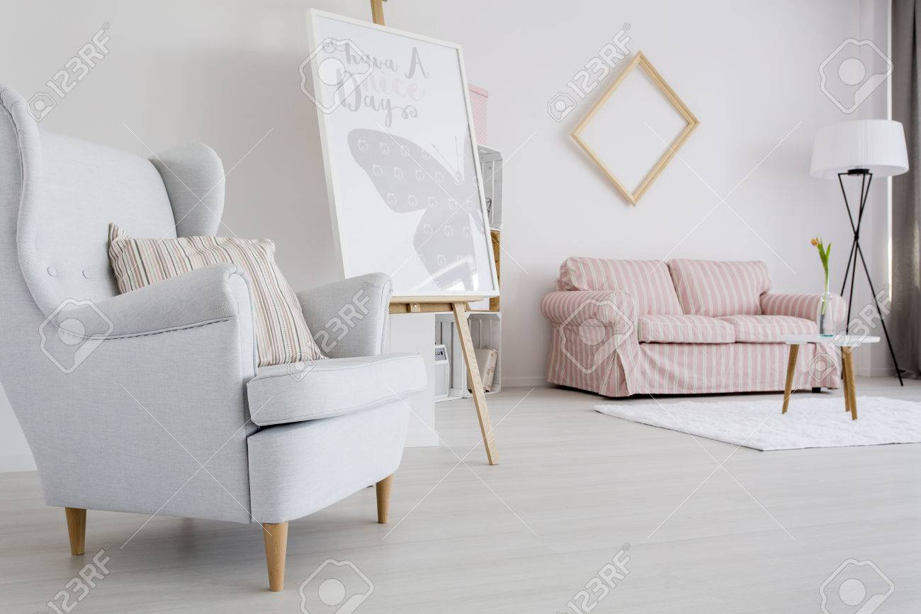 Spacious Feminine Living Room With Light Armchair And Upholstered ...