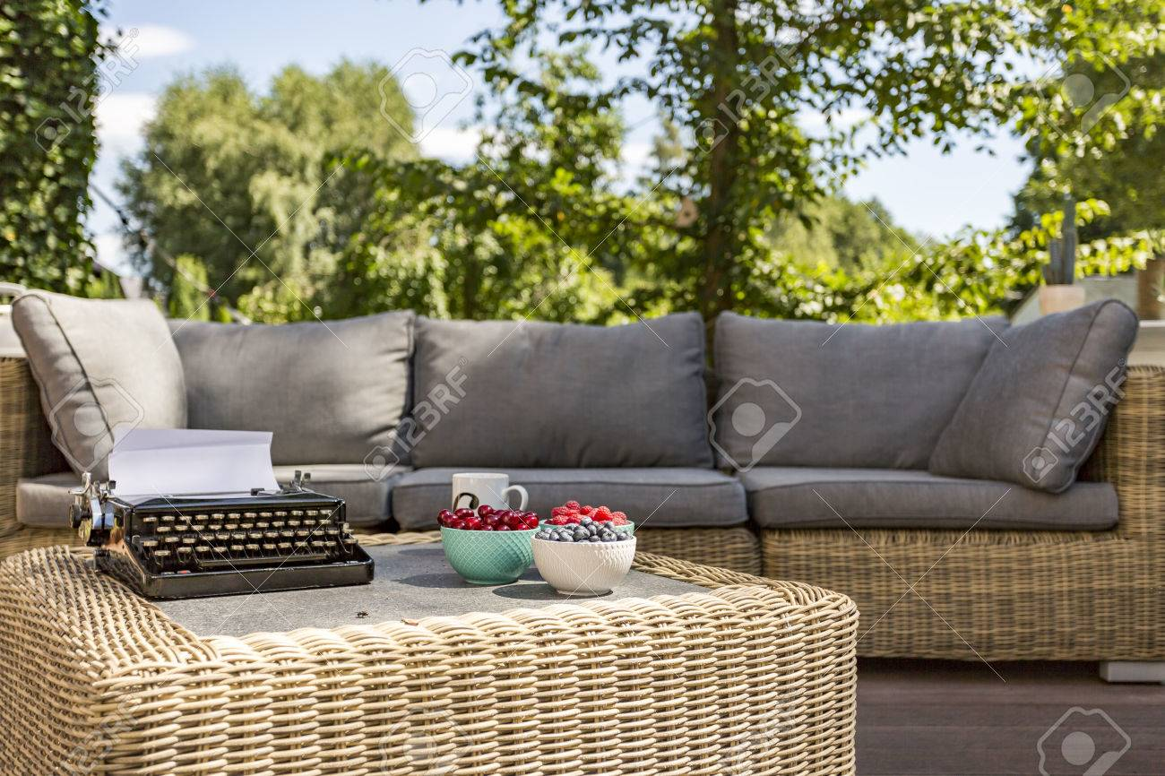Image Of An Outdoor Rattan Sofa And Coffee Table Stock Photo