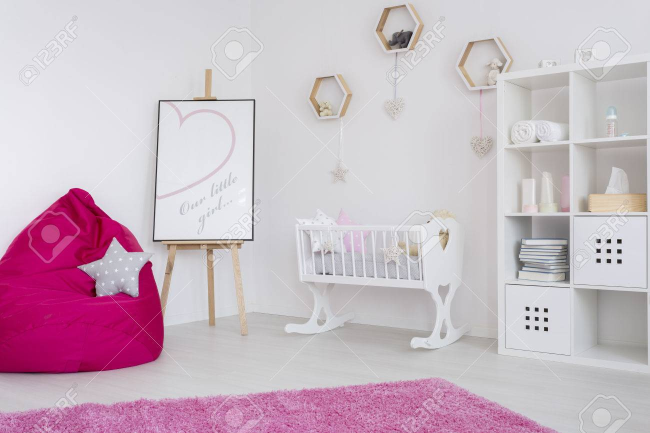 Baby Girl Room In Pastel Colors With A Book Case, Baby Cradle, Easel,